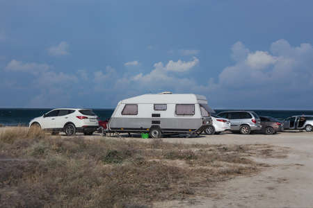 Car camping by the sea on a summer day