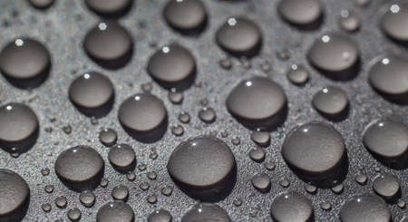 water drops on gray background close-up Standard-Bild