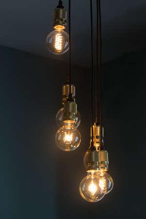 Retro style glowing light bulbs illuminate the room Standard-Bild