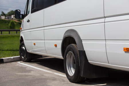 Minibus in the parking lot on a summer day close-up Standard-Bild