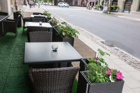 Outdoor sidewalk cafe in the city street