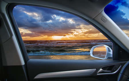 view from the car to a beautiful sunset by the sea