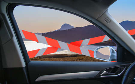Isolation, travel ban, barrier tape.View from the car to the beautiful mountainous seashore