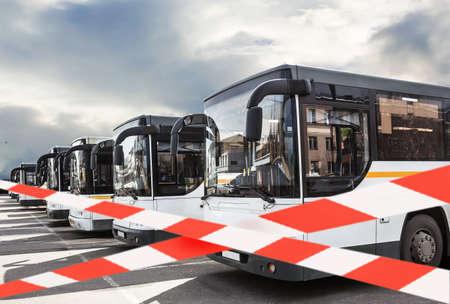 Restriction of public transport, quarantine, virus, isolation, variable tape. Buses in the parking lot. Standard-Bild