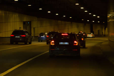 movement of cars in a tunnel lit by lanterns