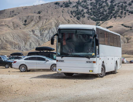 Bus and cars at the weekend on the nature in the mountains