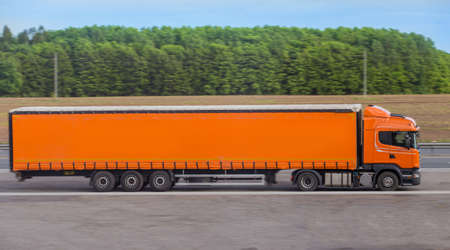 Semi-trailer truck moving on a country road Standard-Bild