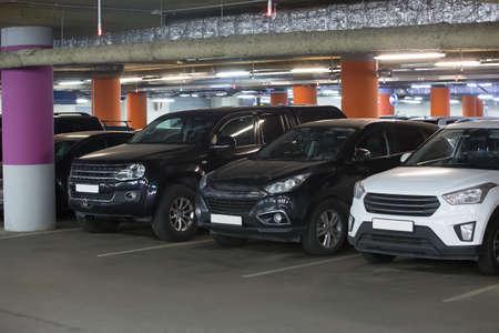 Cars in an underground parking lot under a supermarket
