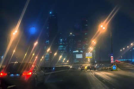 night traffic in downtown in the rain Standard-Bild