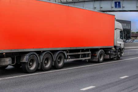 Truck carries goods on a city street