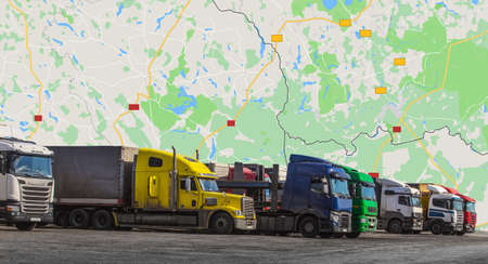Trucks semitrailers on a background of a geographical map Standard-Bild