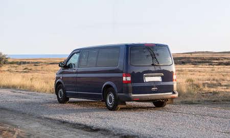 Minivan moves along the road to the sea coast