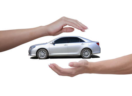 Female hands above and below the car on a white background