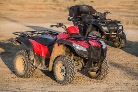 ATVs in the parking lot in the field