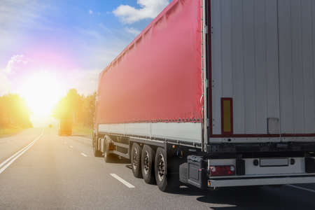Trucks carry goods on a highway in the country
