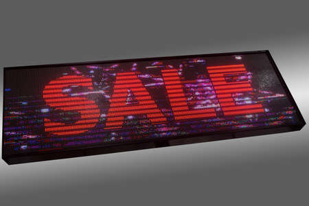 Advertising light diode panel with glowing word SALE isolated on gray