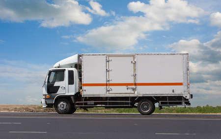 Truck Drives Suburban Highway Sunny Day Cloudy Sky Background Standard-Bild