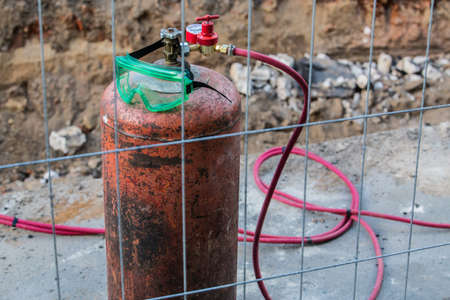 Gas cylinder for gas welding at construction site close-up Standard-Bild