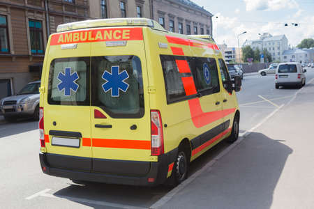 ambulance on the city street in a traffic