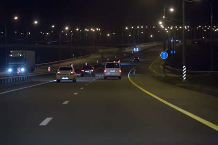 Car traffic at night on a motorway outside the city