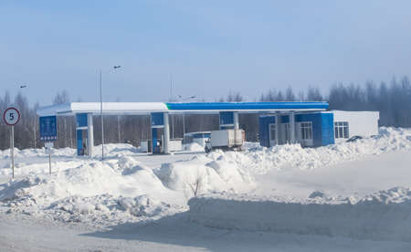 Gas station in winter on suburban highway