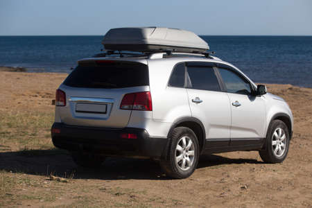 Large SUV on the seashore in summer close-up.