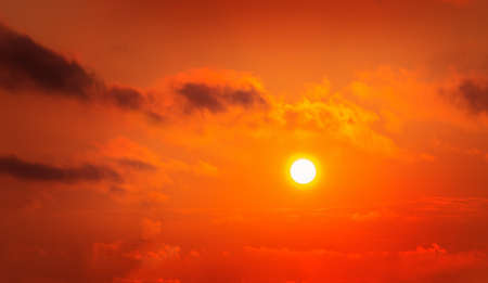 beautiful red sky with sun and clouds Standard-Bild