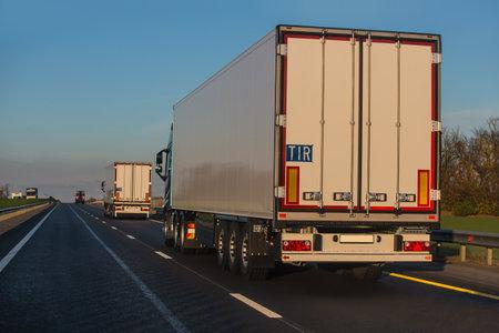 Trucks semi-trailers moving on suburban highway Standard-Bild