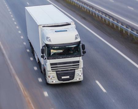 big powerful truck moves on highway Standard-Bild