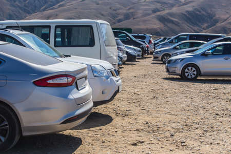 Cars parked outside the mountain range in summer Standard-Bild