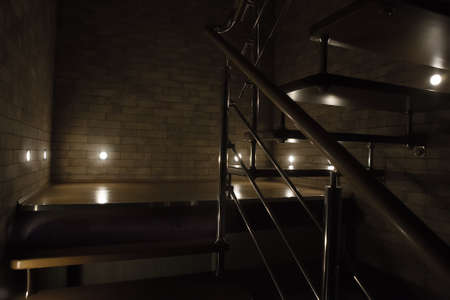 Staircase in a modern house illuminated by LED light Standard-Bild