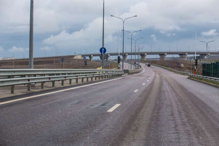 New road junction outside the city in the summer in the rain Standard-Bild