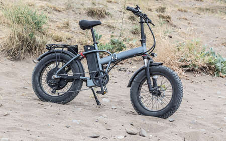 Electric bike on hill in mountains on summer day