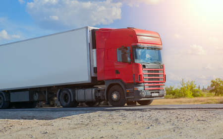 truck transports freight on the country highway