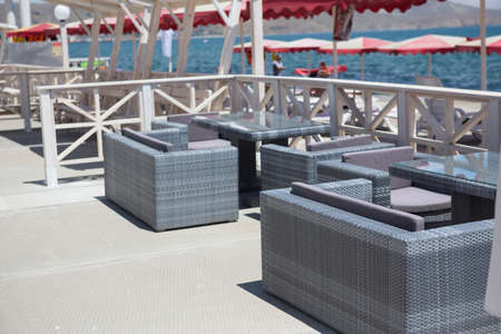 Summer open-air cafe on the seashore on summer day Standard-Bild