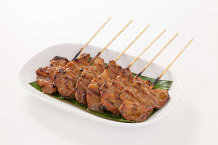 Grilled pork with bamboo stick isolated on white background