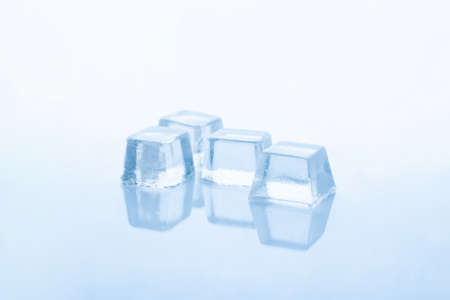 four cubes of frozen ice isolated on white background