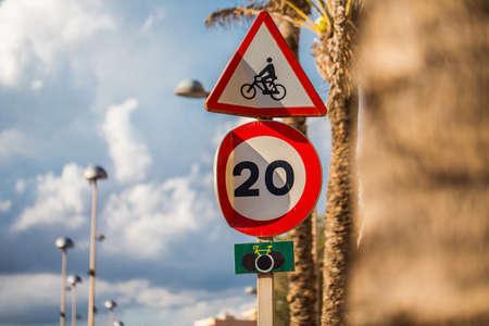 mallorca: Mallorca Speed Limitation Road Sign with palms and sky Stock Photo