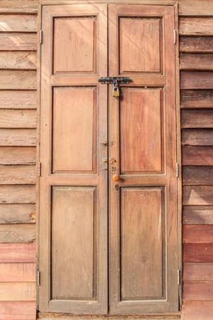 Old wooden door with lock knob lock. photo