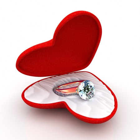 wedding ring in heart-shaped elegant box isolated on white background