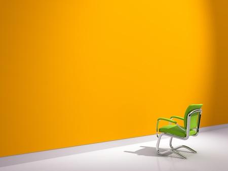 green chair near orange wall
