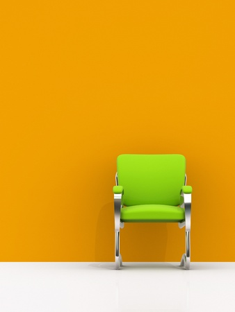 green chair near orange wall