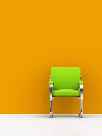 simplicity: silla verde cerca de pared naranja Foto de archivo