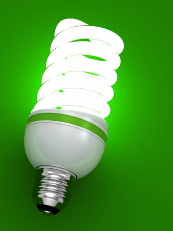 bulb energy saving fluorescent isolated on green background photo