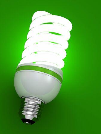 bulb energy saving fluorescent isolated on green background photo