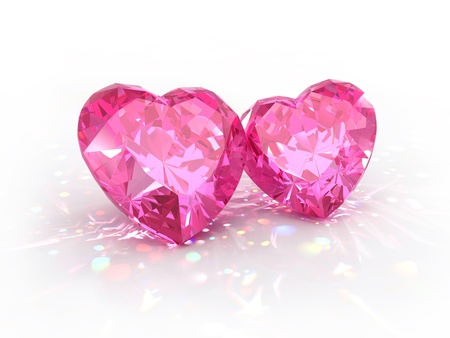 Diamonds jewel hearts for Valentines Day isolated on light background. Beautiful sparkling diamonds on a light reflective surface.