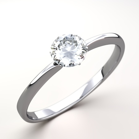 Regalo del anillo de bodas aislado Primer plano de un anillo de oro blanco con diamantes brillante diamante hermoso en una superficie reflectante a la luz photo