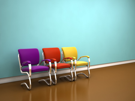 three multi-colored chairs near blue wall