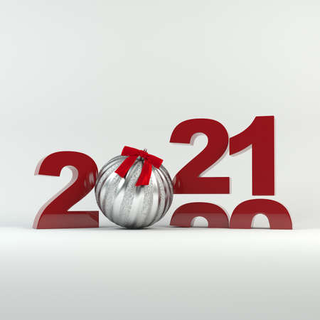 2020-2021 change represents the new year 2021. Silver ball decorated with ribbon. Christmas and New Year 2021 decoration. 免版税图像