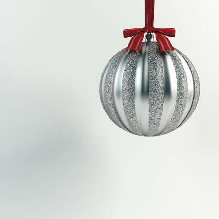 Christmas tree toy hanging on a ribbon. Silver ball. Happy New Year Hanging Baubles. Christmas holiday background. 免版税图像